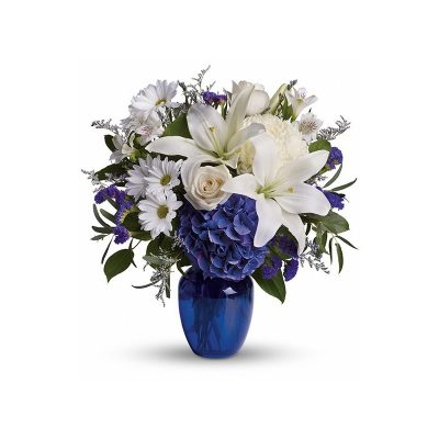 A round handle basket mixed flowers