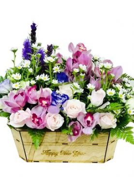 Wooden basket of pink roses