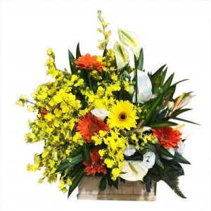 A bamboo basket of mix vibrant blooms