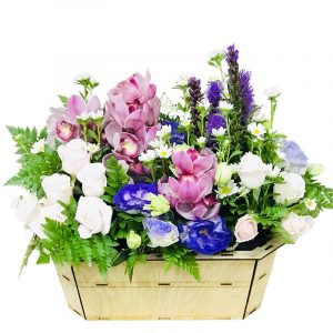 A wooden basket of white rose and orchid