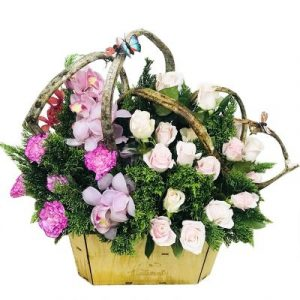 A basket of dedicated pink and white roses
