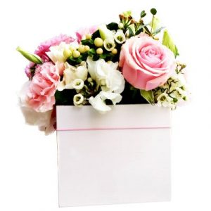 A box of Hot pink roses and carnation accented with assorted greenery