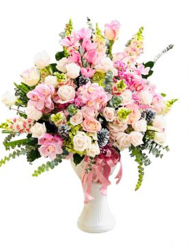 Two dozen of assorted roses and orchid flowers in a vase